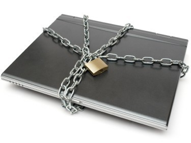 Laptop with heavy chain and padlock.